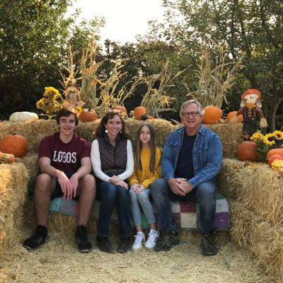 an image of erin and her family on hay bails